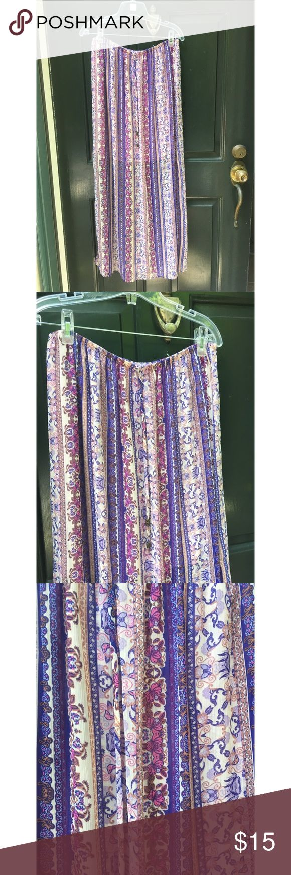 ✨ Purple Boho Paisley Maxi Skirt - Purple Boho Paisley Maxi Skirt - Gorgeous flowy and lightweight boho maxi skirt from Mossimo  - Main colors: purple, white, pink, tan  - Has slip underneath (see photo) and slit on side that comes up to around knee length, two strings in front to tie/tighten  - Elastic waist  - Purchased and never worn, in great condition  - Super flowy and lightweight, perfect for summer!  - Brand: Mossimo / Target - Size: L  *20% off 2+ * Make me an offer!! Mossimo Supply…