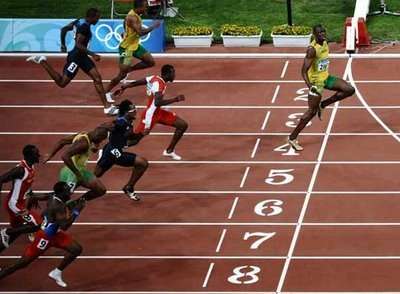 Usain Bolt, Jamaica. jogging over the finish wall having shoe laces undone in the 2008 olympics