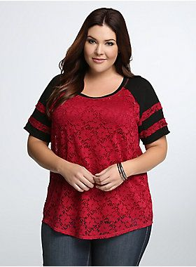 """<p>Flirty-meets-sporty in this allover lace football top. Sexy, semi-sheer magenta lace lends a feminine edge to the borrowed-from-the-boys black football sleeves. Pair the design with a cami underneath, or rock it solo with a bralette.</p>  <p><strong>Model is 5'9"""", size 1</strong></p>  <ul> <li>Size 1 measures 28 1/2"""" from shoulder</li> <li>Nylon/spandex/polyester/rayon</li> <li>Wash cold, dry flat</li> <li>Imported plus size top</li> </ul>"""