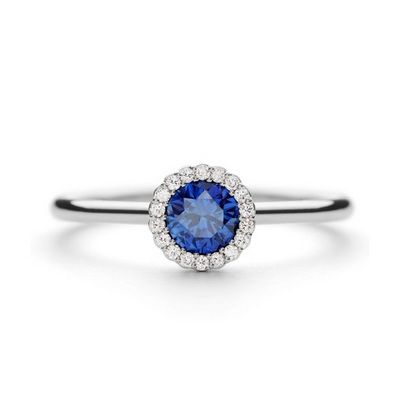 ANDREW GEOGHEGAN CANNELE Bridal Sapphire. 40pts total. Brilliant cut sapphire 33pt centre stone Surrounding stones brilliant cut diamonds approx 7pts G VS as standard. Set in platinum Court profile.	 Ref. No.01-13-041 PRICE: £2,150
