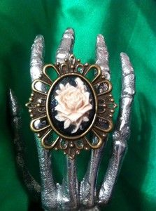 on ebay. Antuqued Flower cameo ring