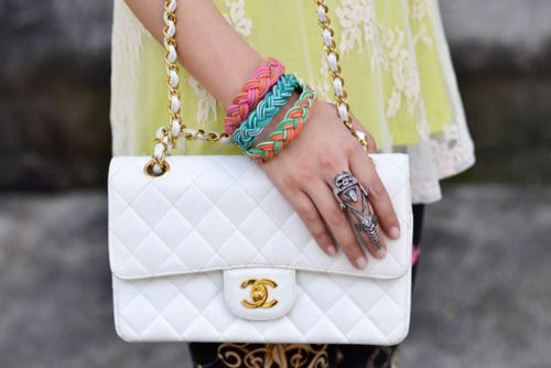 white chanel. big ring. colored bracelets...