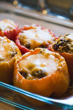 Best Stuffed Peppers Recipe - Seriously, the flavor is so amazing. This stuffed peppers recipe features ground beef, sausage, rice and lots of cheese. SO GOOD.