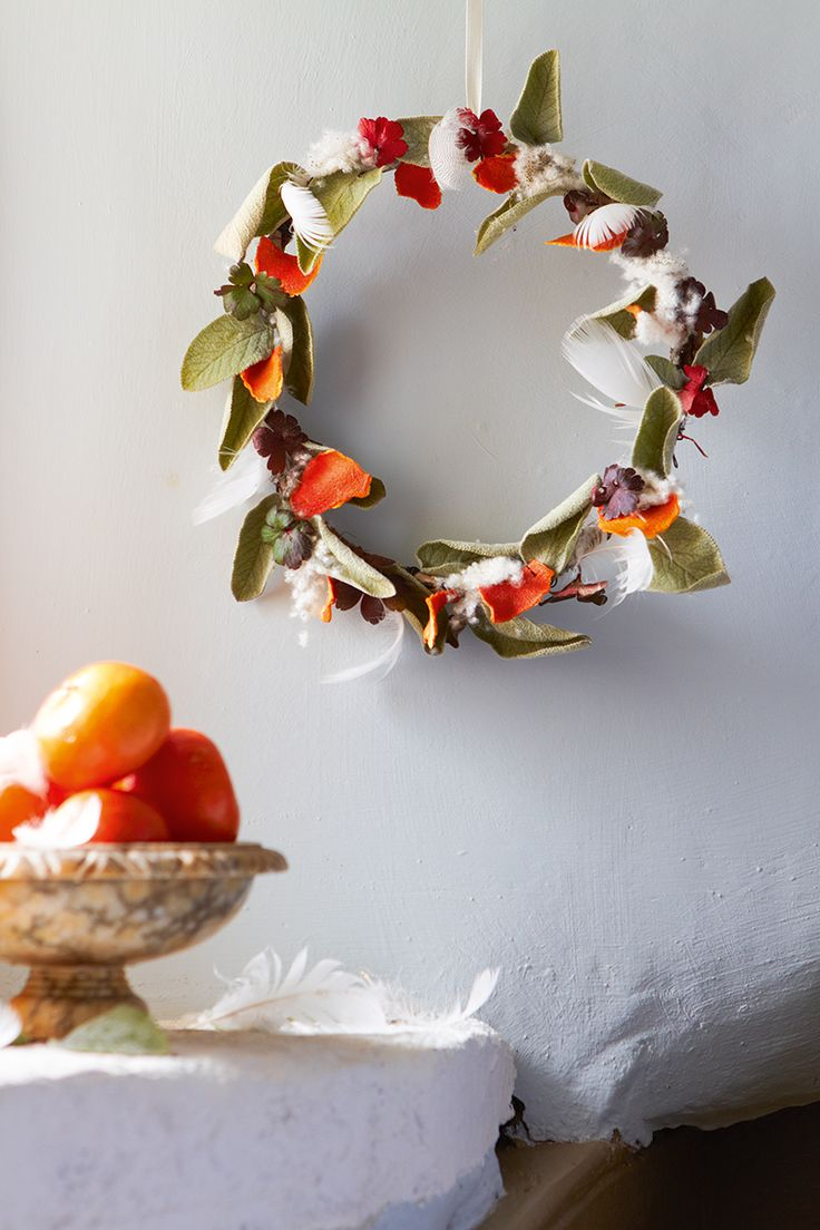 Sage, clementine and feather wreath Photo by Britt Willoughby Dyer