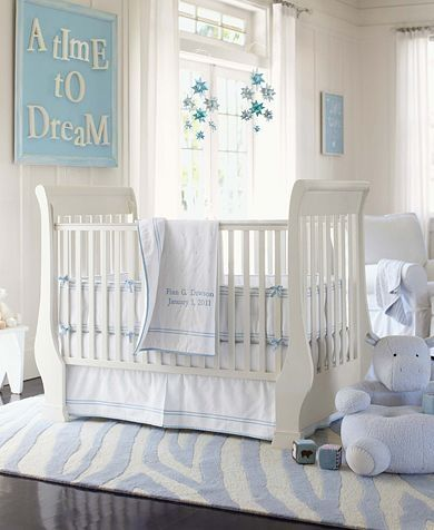 Love the soft blue and white for a boy nursery. The rug isn't favorite!