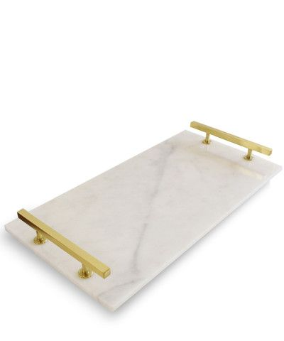 http://www.highstreetmarket.com/collections/new/products/modern-carrara-marble-serving-tray-brass