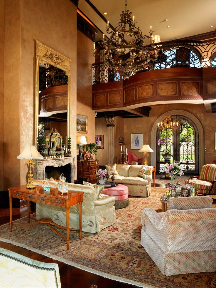"""(BrandonRugs.com) This is a hand-knotted Pak-Peshawar oriental rug on the floor (reproducing a traditional Indian Agra design) Behold, a patterned rug with a subdued palette is the suitable groundwork for this """"Awesome"""" room."""