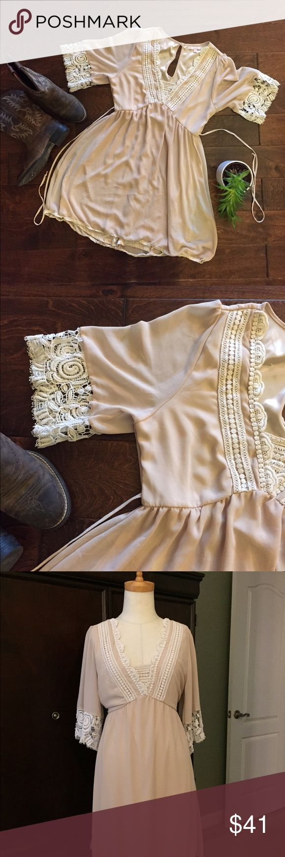 💥 Beige Blush Sheer Baby Doll Dress With Lace 💥 NWOT Adorable sheer baby doll dress with lace trim. Size large juniors. Adorable with boots. I bought this dress to wear to a Kenny Chesney concert but it is too small for me. The color is a dark beige but kind of has a blush tone to it. Full satin slip. Ties in the back. Thin lace hem. Dresses