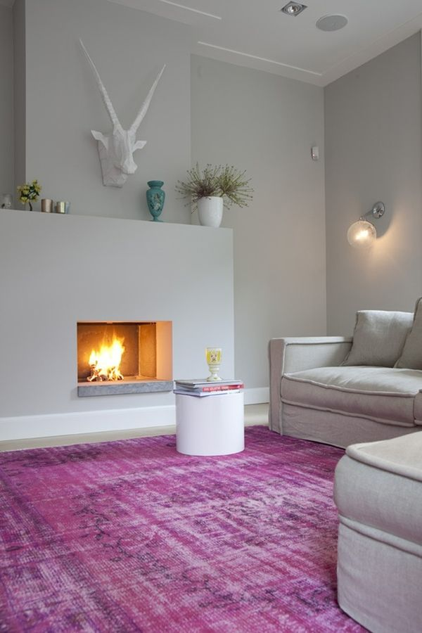 Wonderful to add color to a room : through a rug. I love how the pink/fuchsia/purple does not give this room a feminine feel by keeping all the other accessories neutral, minimal, and modern.