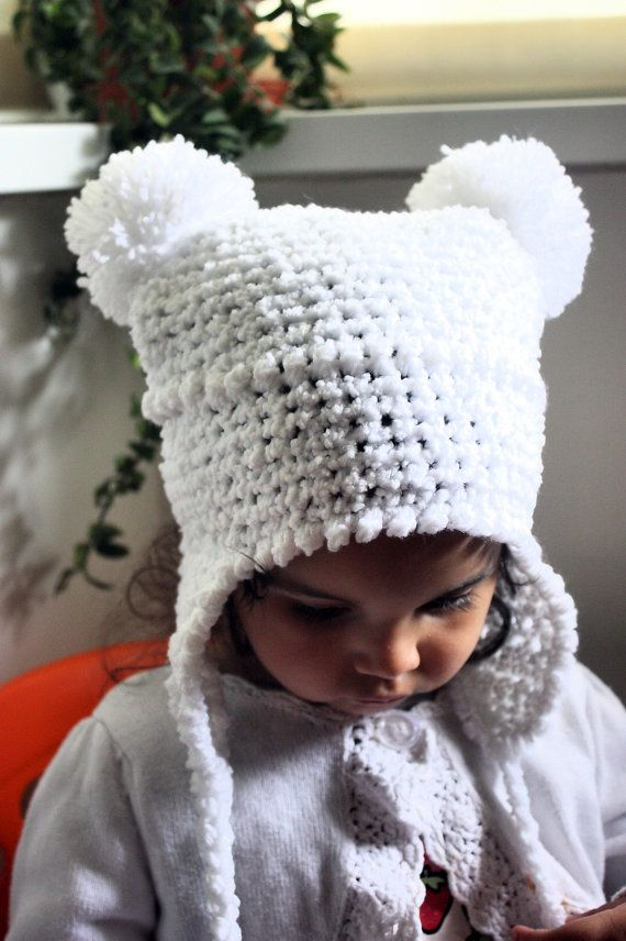 SUMMER SALE* Children's crochet white sparkle double pom pom earflap hat (can be customised with your colour preference). Handmade with love by Babamoon   - size 6 to 12m -   * Can be made in a choice of colours  * Can by made in sizes Preemie to Adult.  * Order now for Halloween!  * Get 20% off! minimum order applies ->