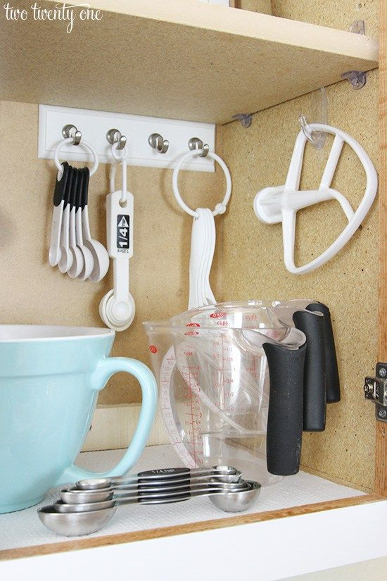 Organized baking cabinet. Command hooks!