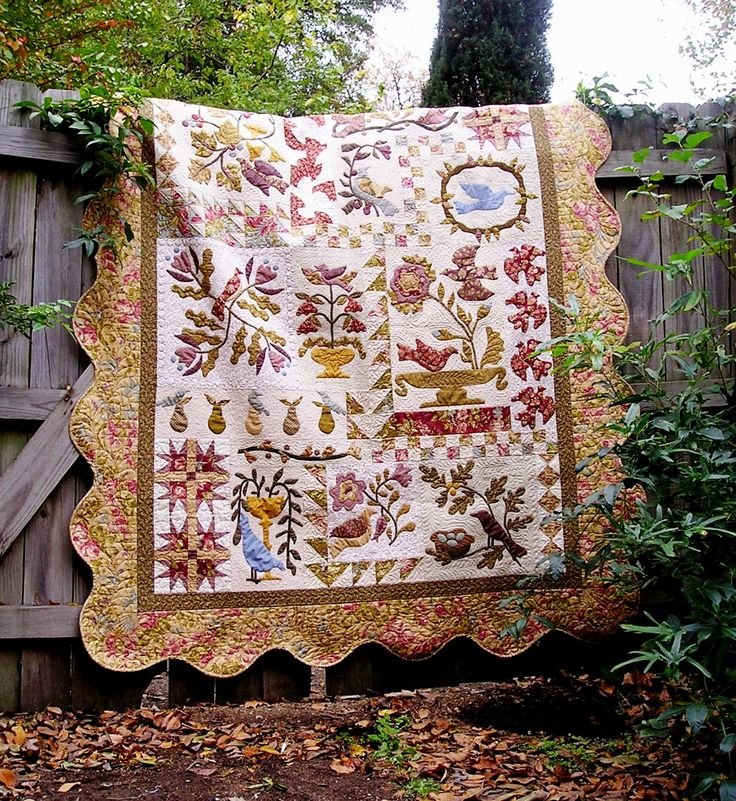 Birds of a feather quilt.... lots of applique and heavily quilted