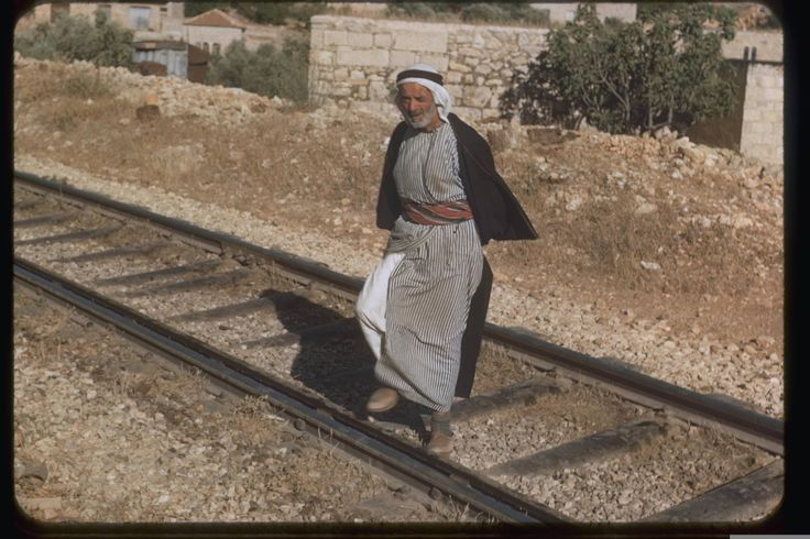 Arab man crossing a railway track in Jerusalem, July, 1950, Katcoff collection. אזור בית צפאפה