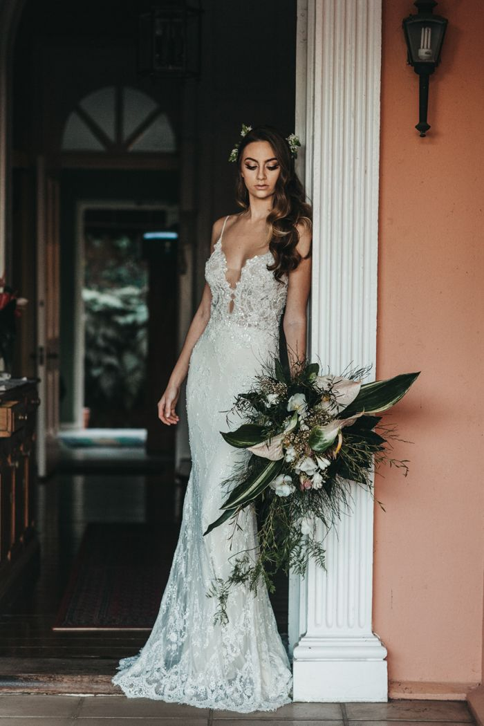 Gorgeous peach and green tropical wedding portrait inspiration | image by Michigan Behn Photography  #weddingdress #bridalportrait #bridalstyle #bridalfashion #bridalinspo #bridalinspiration #bride #bridalhair #bridalhairstyle #bridalmakeup #summerbridalstyle