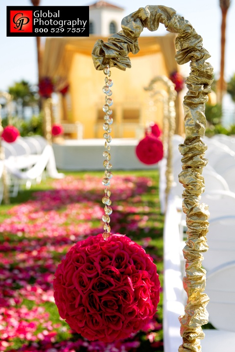 aisle decor in pink, red, and gold