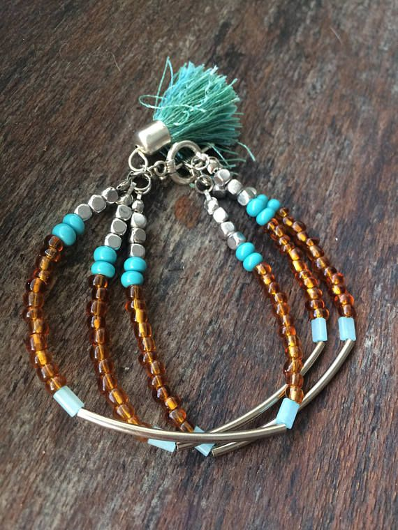 OoaK Multi Strand Beaded Tassel Bracelet, Boho Bracelet, Hippie Bracelet, Tassel Bracelet, Turquoise Silver Brown Beaded Gypsy Bracelet Beautiful Multi Strand Beaded Tassel Bracelet, 7 and quarter inches long. A perfect addition to your outfit for those beachy, boho summer vibes.