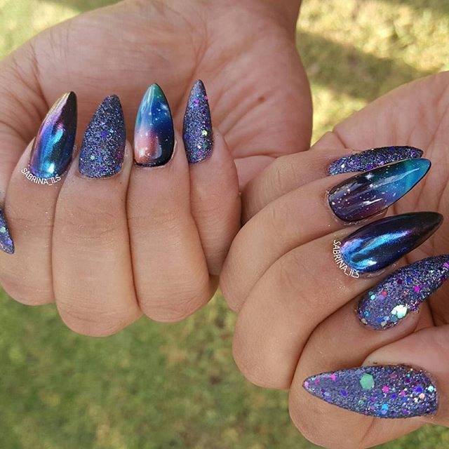 Client was inspired by the galaxy 💜💚💙👽👾🌌🌌🌌🌚🌜🌞🌟☄🌠🌠🌠 ___ #sculpturednails#sculptednails#youngnails#nailporn#swarovskinails#vegas_nay#hudabeauty#wakeupandmakeup#laurag_143#sabrina_ils#insta_makeup#slave2beauty#fcnails#anaheimnails#ocnails#ocnailtech#galaxynails#chromenails