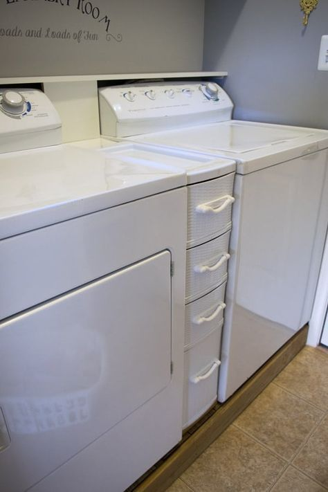 This is our small closet Laundry Room Makeover - Cabinet and Open Shelves for organization and storage in light grey and yellow color scheme.