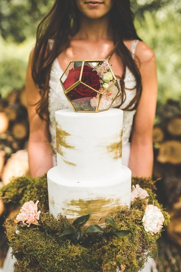This stunning white and gold cake is taken up a notch with the glass terrarium topper | Image by Xandra Photography