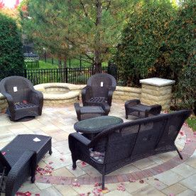 Paver Patio With Stone Wall And Fire Pit