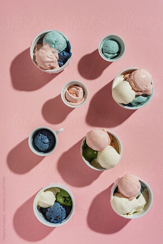 Colourful pastel blue, teal and pink ice cream on pink pastel background by photographer Tatjana Ristanic | Photography