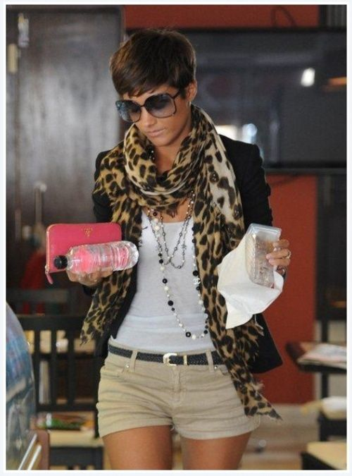 Black blazer, tan pants, white t-shirt, animal print scarf.