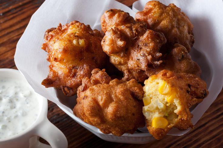 This crispy corn fritter recipe mixes fresh corn kernels into a cornmeal batter that gets deep-fried and served with tartar sauce.