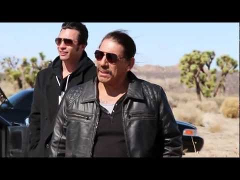 """http://GiantApe.com  Watch Eric St. John """"Take a Bullet to the chest"""" from Danny Trejo in this behind the scenes video of the new action movie BULLET. Cult action hero Danny Trejo is Frank Bullet who takes on a ruthless cartel in a race against time to save his family. The body count just keeps rising in this gritty action film laced with typical Trejo humor."""