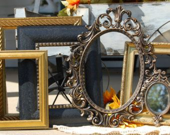 Vintage/ Recycled Wall Accents- *Open* Wall Decor in Shabby Chic, Beach Cottage Home Decor  We have upcycled/recycled these 5 vintage/recycled resin, & metal frames for wall hanging Painted in Antique White & Classic White All frames were given a distressed-rustic/worn finish by hand  *READY TO SHIP*   These are 5 separate pieces ***********Frames come WITHOUT glass,backings, or hardware for wall hanging.********* This Frame set does not have glass, backings or any hardware. These are empty…