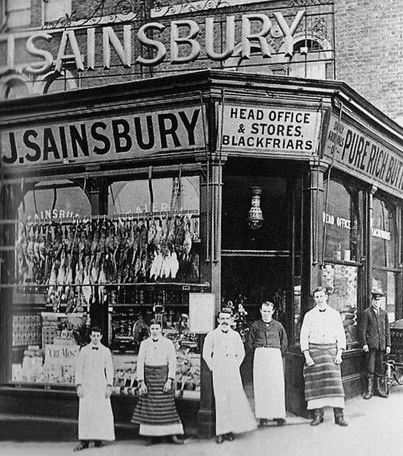 J. Sainsbury pre-1900. Wonderfully busy window displays and a team of helpers pose for the photographer.