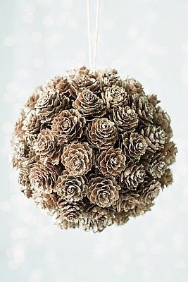 Styrofoam ball, hot glue pine cones, attach ribbon for hanging.