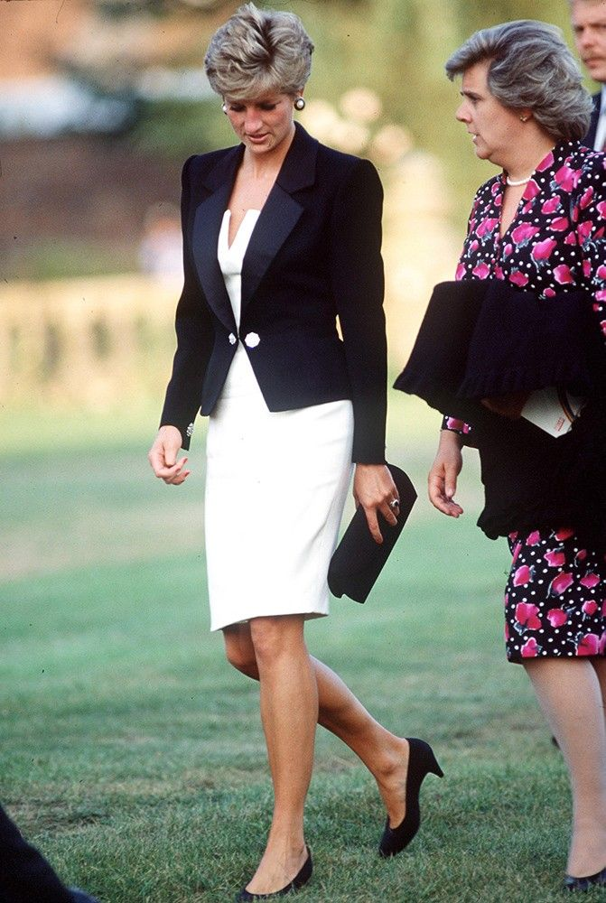 Diana wore this white dress and black jacket designed by Catherine Walker during a visit to Salisbury. via StyleList
