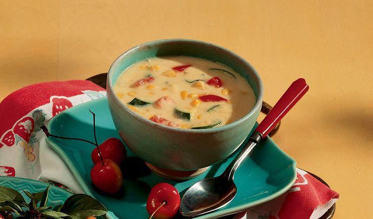 Harvest your garden bounty for this cheesy garden vegetable soup recipe. Zucchini, corn and tomatoes in a creamy base of Colby and Cheddar making a satisfying, savory chowder.