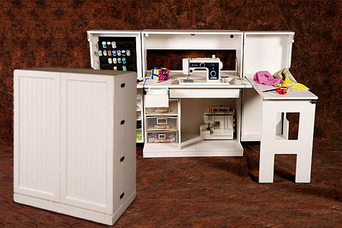 A sewing area that can be folded away into a cabinet! Love it!