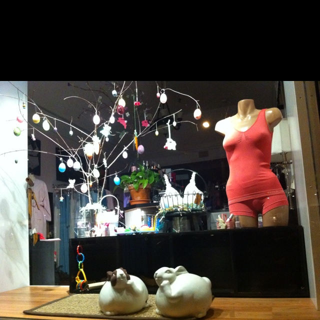 "Evening view of our window with the overnight stand in bunnies, ceramic ""piggy"" banks painted to look like the real bunnies, Charlie & Skittles!"