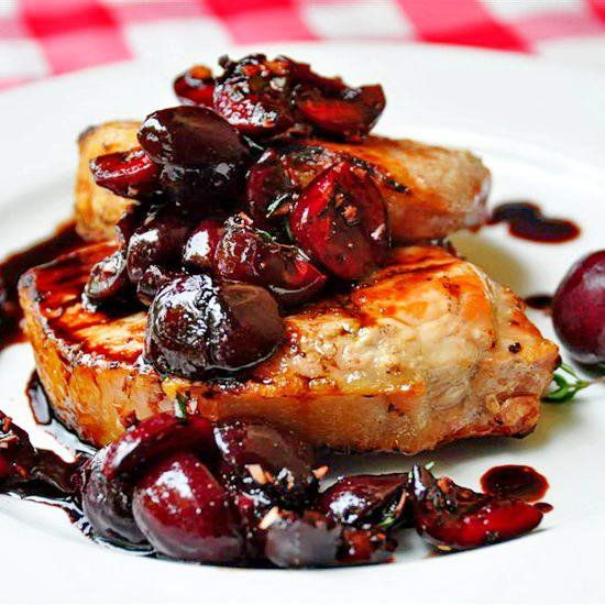 Grilled Pork Loin Chops with Balsamic Thyme Cherries -  Perfectly grilled pork chops served with cherries & thyme marinated in a balsamic vinegar reduction.