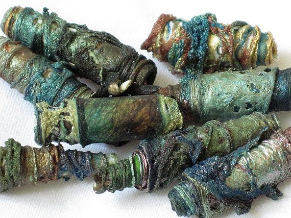 art beads hand made with Tyvek  http://www.etsy.com/listing/74554226/mixed-media-textile-art-beads-hand-made