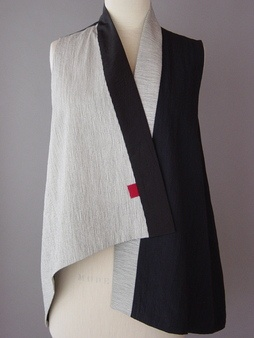 Juanita Giradin vest. Asymmetrical Vest in Black & Beiges Stripe    Japanese cotton fabric with fine irregular lines printed on a black ground. Embroidered lines and all quilted to silk.