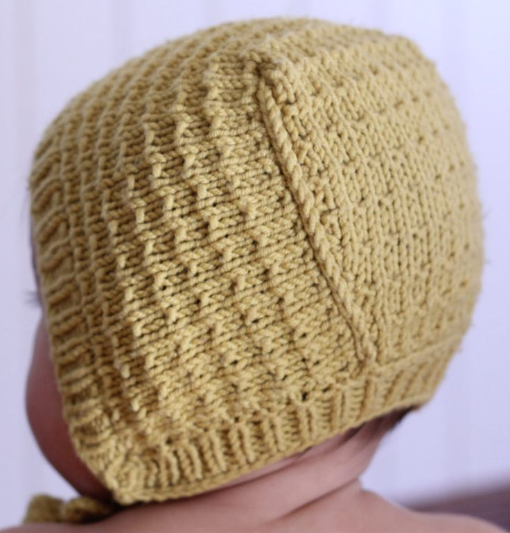 Knitting Pattern for Easy Astrid Baby Bonnet - The easy Astrid textured bonnet design was inspired by illustrations in old Nordic children's books. Suitable for beginners. Sizes 3m-2 y. In both English and Norwegian.