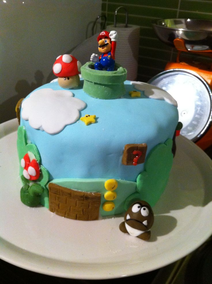 Harvey's 10th bday Mario cake.  Had so much fun making this cake. Only thing I had to buy was Mario himself. The rest was fondant icing (just like playing with play dough - BRILLIANT FUN)