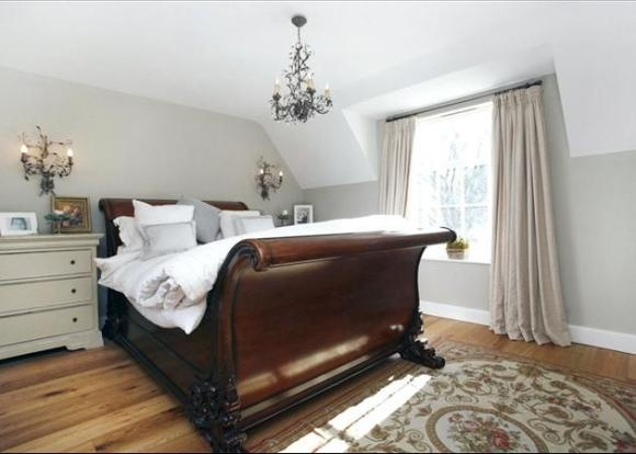 Sleigh bed with white bedside tables for our master bedroom