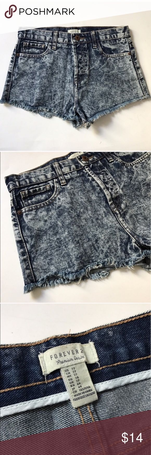 "Forever 21 acid wash shorts Forever 21 distressed acid wash shorts. Size 27. Inseam measures 2"". Rise measures 11"". Waistband measures 29"". Five pockets. Zipper and four button closure (three hidden buttons). Very good used condition! 🚫NO TRADES🚫 💲Reasonable offers accepted💲 💰Ask about bundle discounts💰 Forever 21 Shorts Jean Shorts"