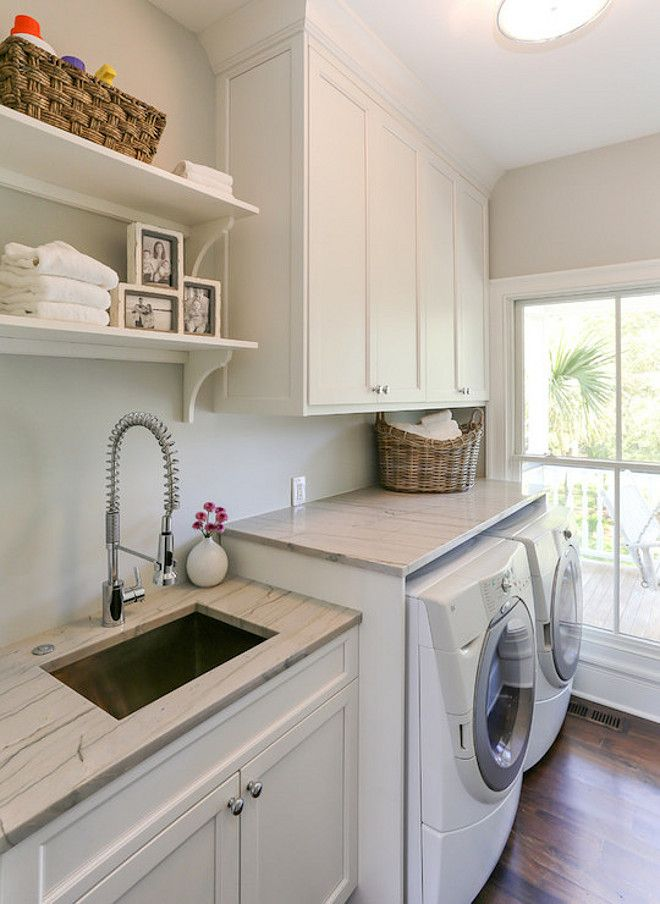Laundry Room Laundry Room With White Cabinets Accented With Nickel Hardware And White Quartzite Countertops