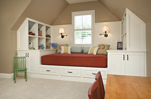This room does double-duty as a playroom and guest room. Built-ins provide plenty of storage and function in a small nook. The bed can be used daily for sitting and playing, and is still useful for accommodating overnight guests.
