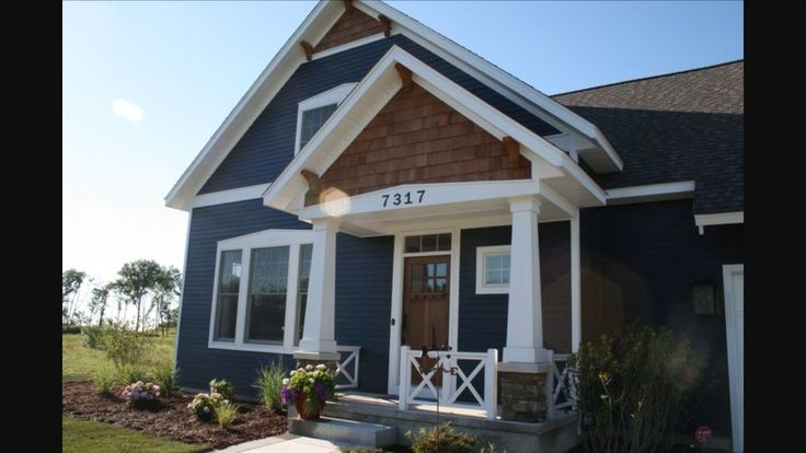 Blue house with white trim and cedar shakes