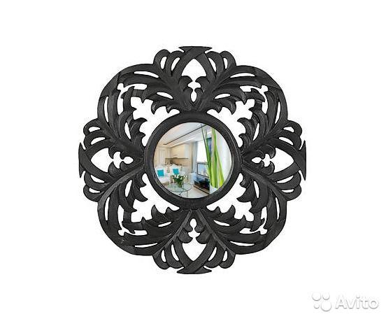 Необычное зеркало в резной черной раме из дерева