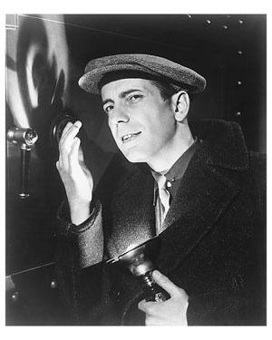 Humphrey Bogart  From the outfit, I'll guess this is from the set of Dark Victory, where he played an Irish horse trainer.