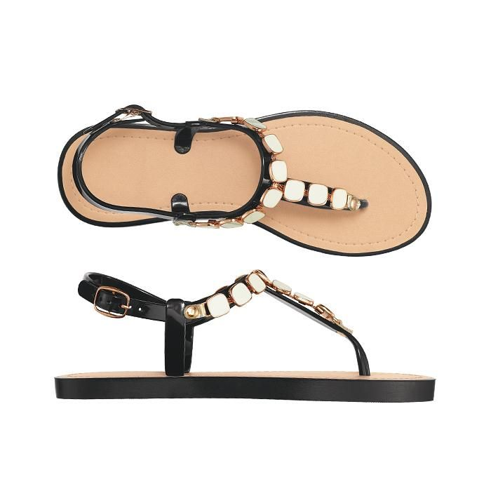 Enameled Chain Thong Sandal. This jelly style is updated with chic, faceted metal discs and a non-jelly textured footbed for traction. A perfect summer statement!  FEATURES• Black sole with natural footbed• Faceted gold metal discs on thong straps• Non-jelly textured footbed for traction• Adjustable jelly straps embellished with enamel-like accents• Ankle strap with gold buckle  MATERIALS• PVC (Poly Vinyl Chloride)  Made in China.