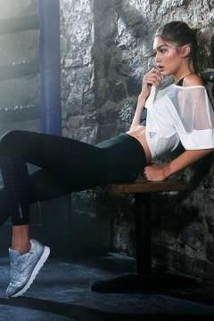 Gigi Hadid wearing Reebok x Face Stockholm Classic Leather Spirit Sneakers in Silver Presence