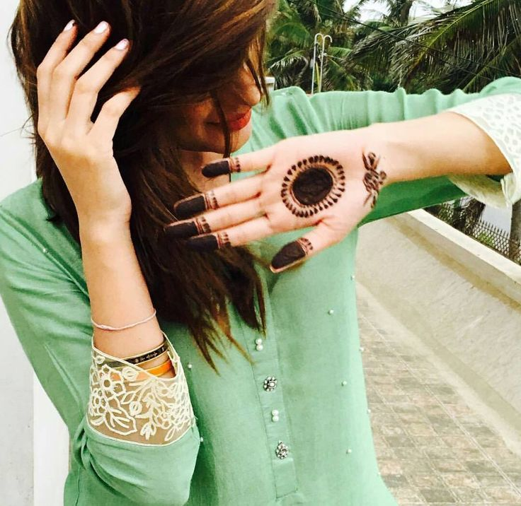 Mehwish Hayat is surely flaunting her mehndi but, you can't take your eyes off from that soft mint coloured top.#crushing on the top#go desi.